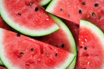 close up photography of sliced watermelons