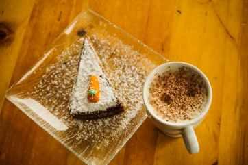 white ceramic cup and dessert